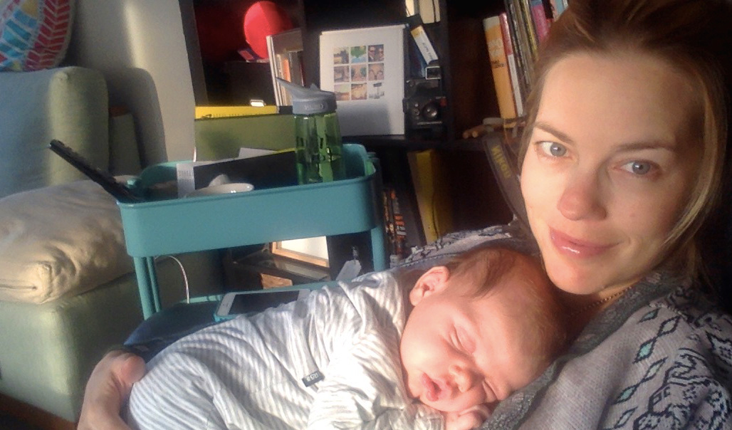 Smiling through the pain – The first two weeks with a newborn are pretty hellish…